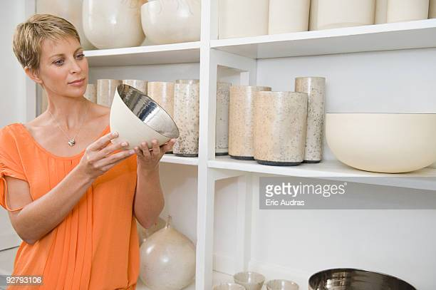 Woman holding a bowl in a store