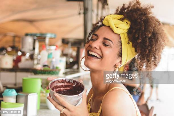 woman holding a bowl with acai at ver o peso market, in belem do para - acai stock pictures, royalty-free photos & images