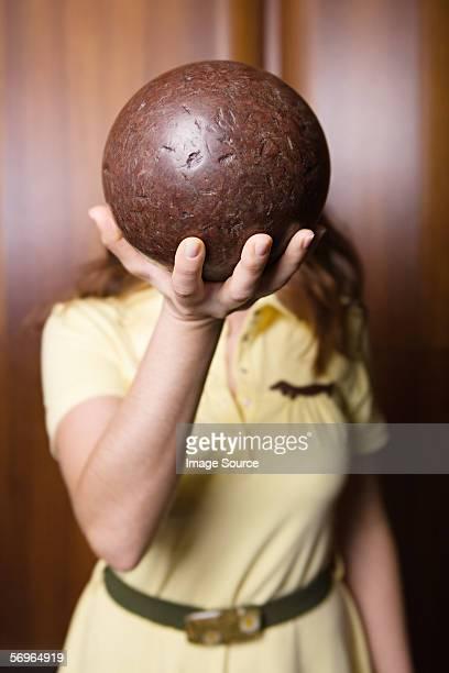 Woman holding a bowling ball