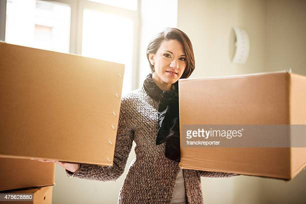 Woman holding a box on a new house