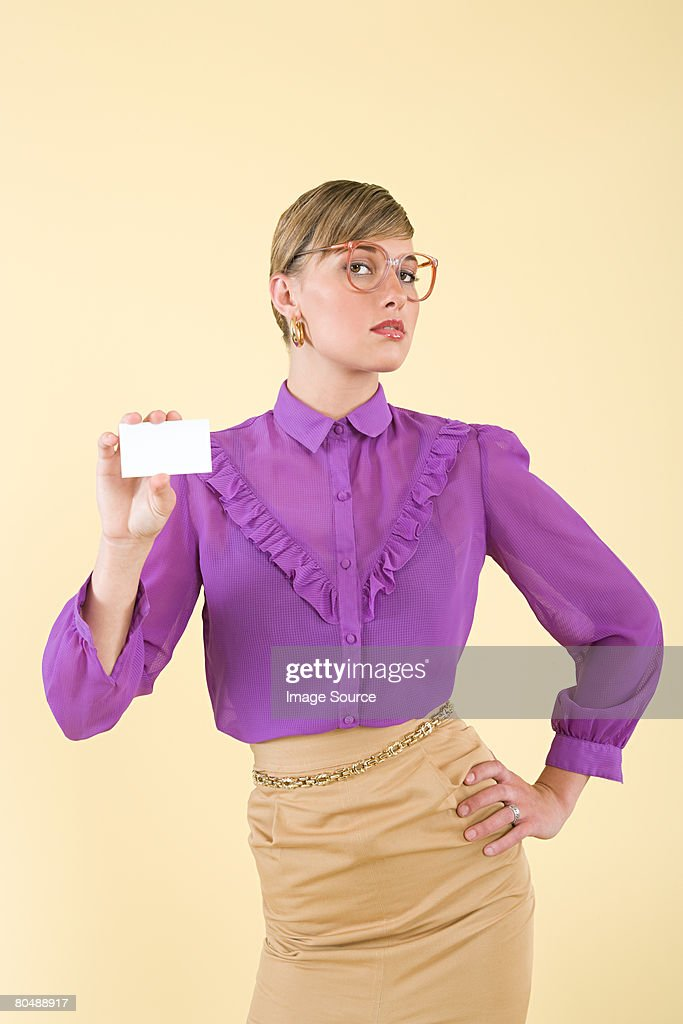 A woman holding a business card : Stock Photo