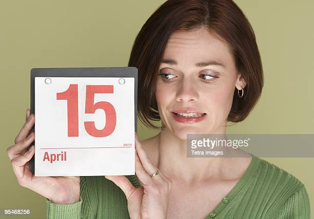 Woman holding a calendar on April 15th
