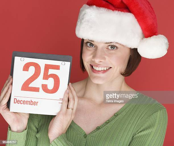 Woman holding a calendar on December 25th