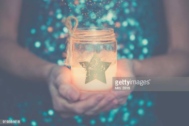 woman holding a candle in her hands - 40 44 jaar stock pictures, royalty-free photos & images