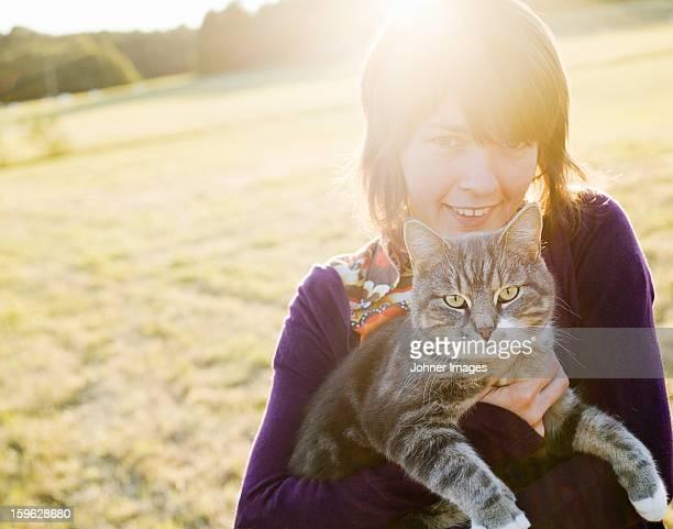 A woman holding a cat, Sweden.