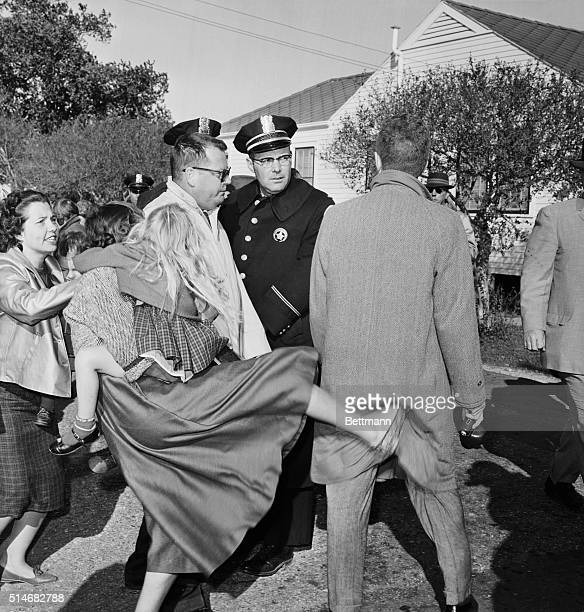 A woman holding a child lashes out at a man during a desegregation protest at William Franz Elementary School in New Orleans Louisiana | Location...