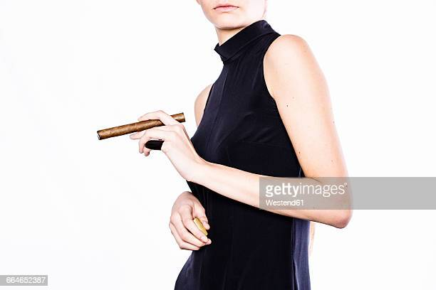 woman holding a cigar, partial view - sleeveless stock pictures, royalty-free photos & images