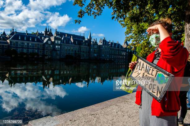 Woman holding a climate placard close to the House of the Parliament during the demonstration. The climate activist group, Extinction Rebellion in...