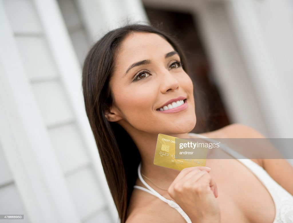woman holding a credit card stock photo getty images