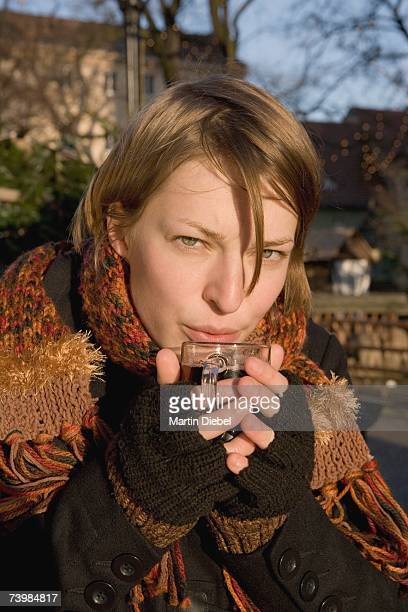 Woman holding a cup of mulled wine