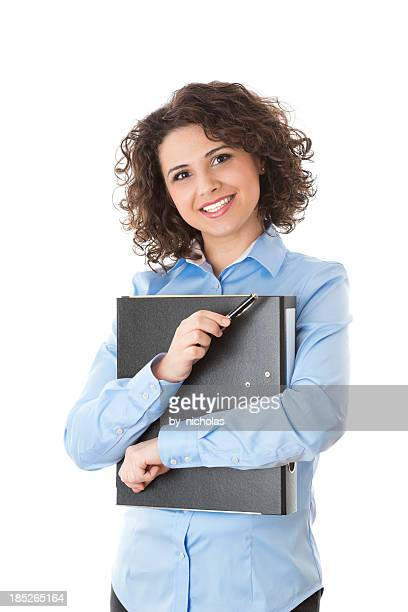 Woman holding a folder, looking at the camera