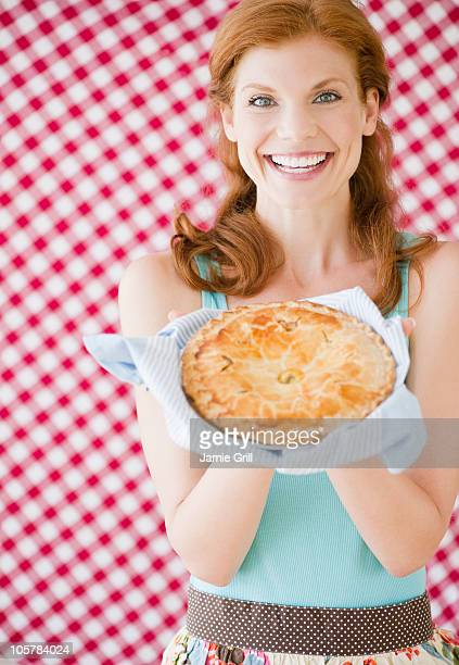 Woman holding a freshly baked pie