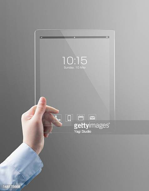 Woman holding a futuristic digital tablet