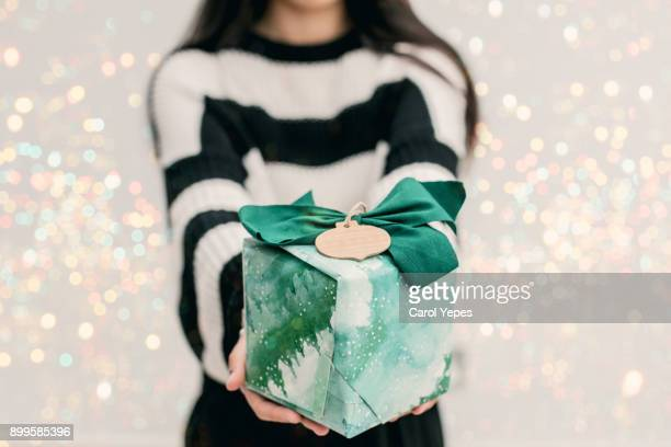 woman holding a gift box - giving stock photos and pictures