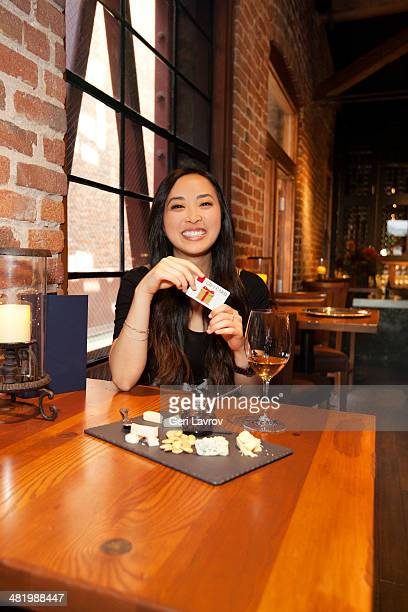 Woman holding a gift card at a bar lounge