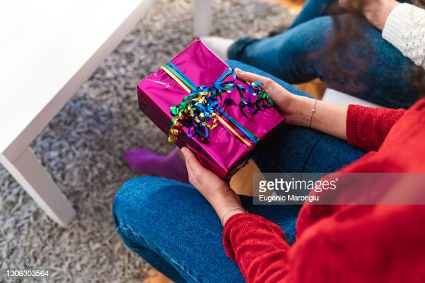 woman holding a gift - 20 24 years stock pictures, royalty-free photos & images