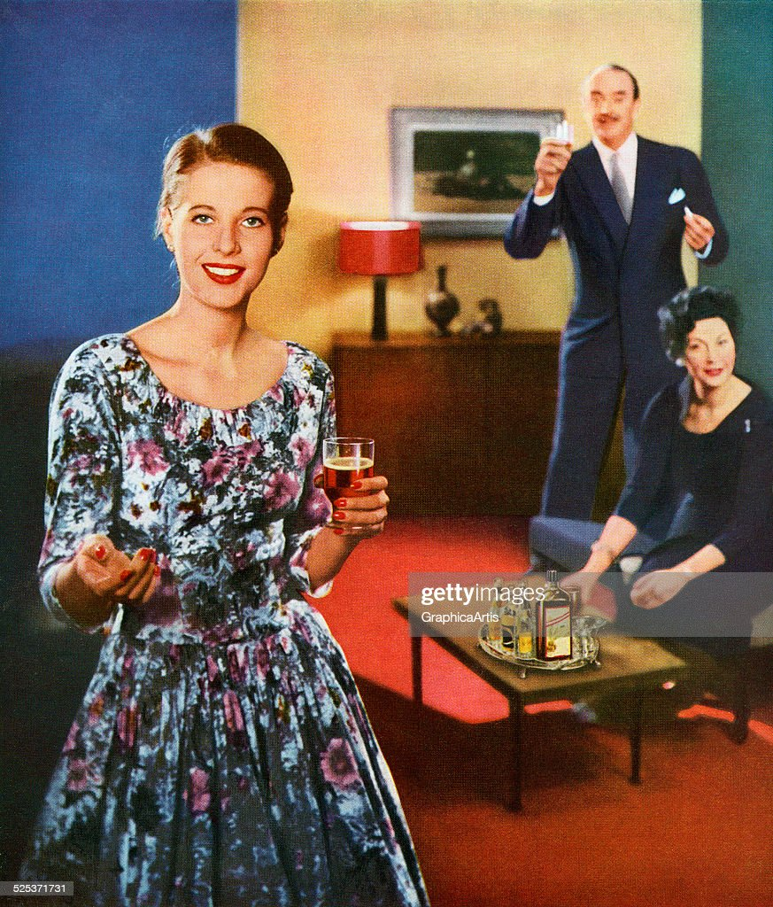 Woman Holding Glass Of Whiskey : News Photo