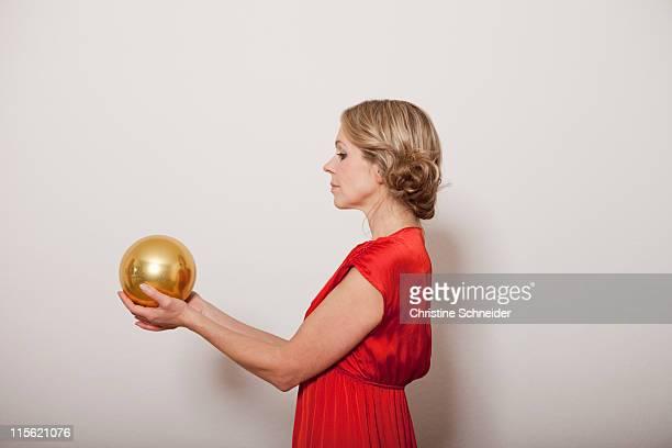 Woman holding a golden ball
