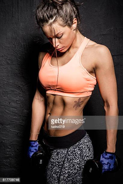woman holding a hand weight - black female bodybuilder stock photos and pictures