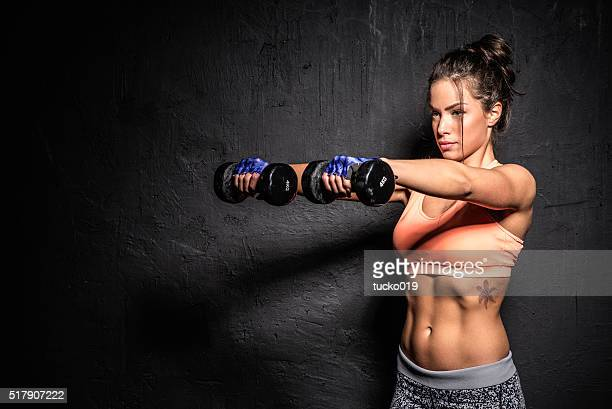 woman holding a hand weight - hand weight stock pictures, royalty-free photos & images