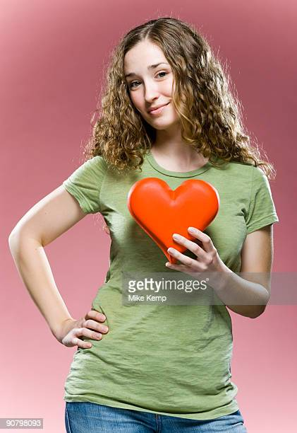 woman holding a heart to her chest