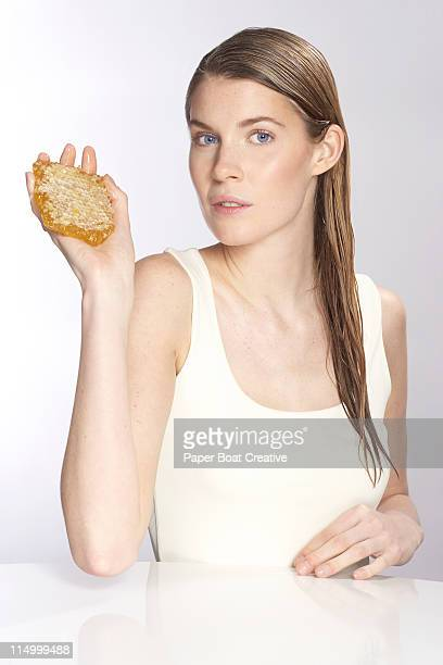 woman holding a honeycomb in her hand