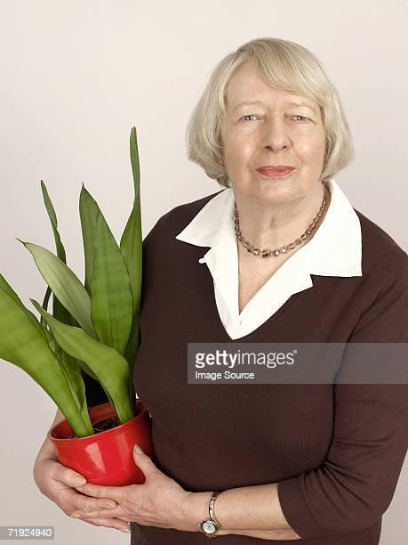 Woman holding a houseplant