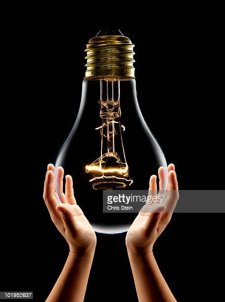 Woman holding a large lightbulb