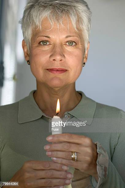 woman holding a lit candle - candle of hope stock pictures, royalty-free photos & images