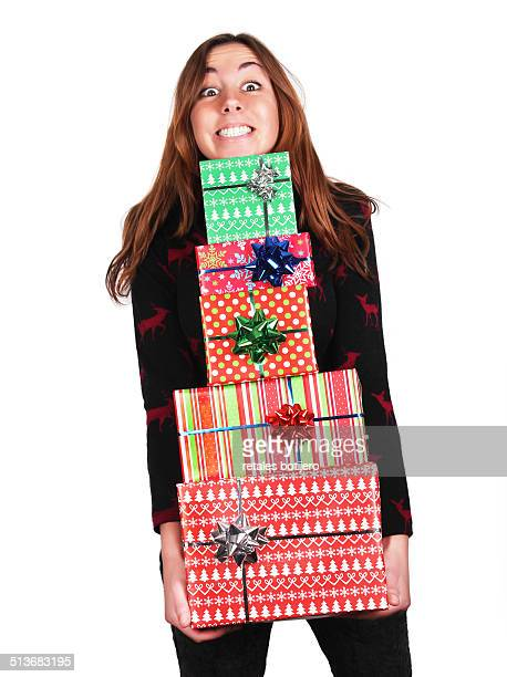 Woman holding a lot of Christmas gifts