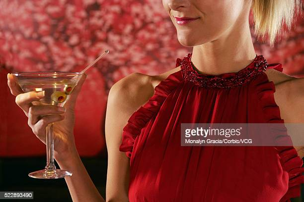 Woman holding a martini