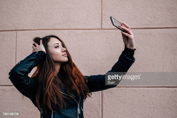 Woman holding a mobile phone taking a selfie