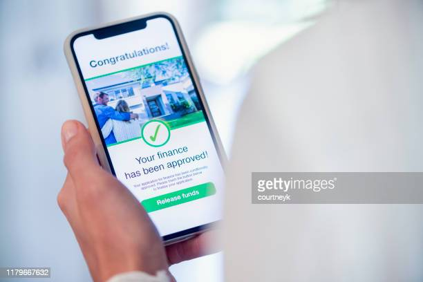 woman holding a mobile phone with loan application approval. - permission concept stock pictures, royalty-free photos & images