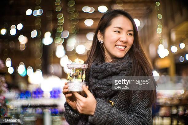 Woman Holding a music box