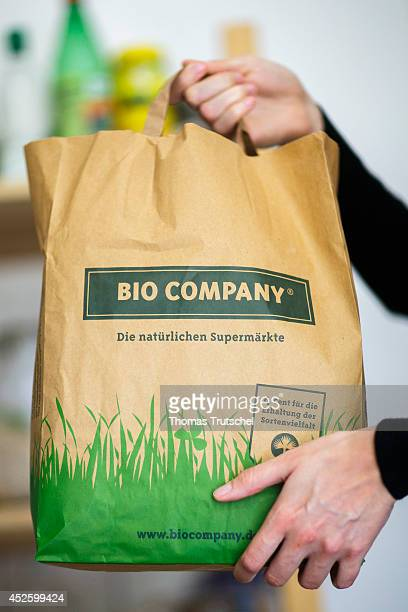 Woman holding a paper bag of the German organic food chain store Bio Company on July 13 in Berlin Germany The Bio Company offers a food assortment...