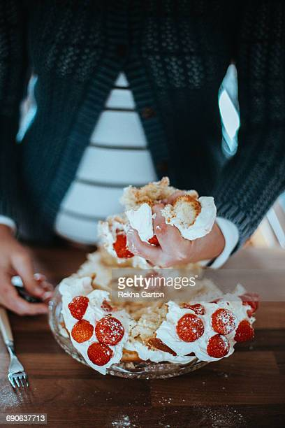 woman holding a piece of cake - rekha garton stock pictures, royalty-free photos & images