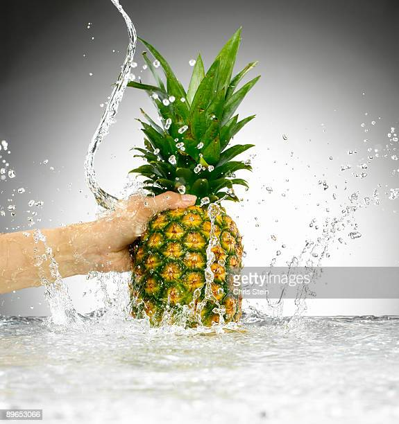 Woman holding a pinapple