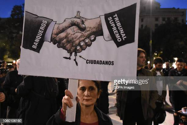 A woman holding a placard against the Supreme Court decision during the demonstration against the Spanish Supreme Court decision of clients and not...
