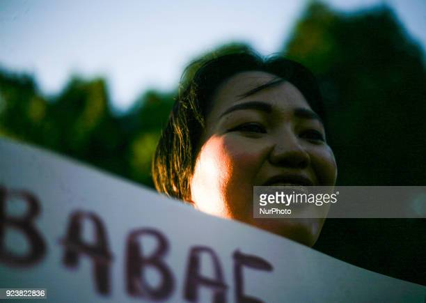 A woman holding a placard chants slogans during a protest ahead of the 32nd anniversary of the EDSA People Power Revolution at the People Power...