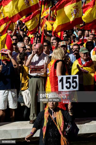 A woman holding a placard demanding de article 155 during a demonstration demanding the unity of Spain and against the independence of Catalonia