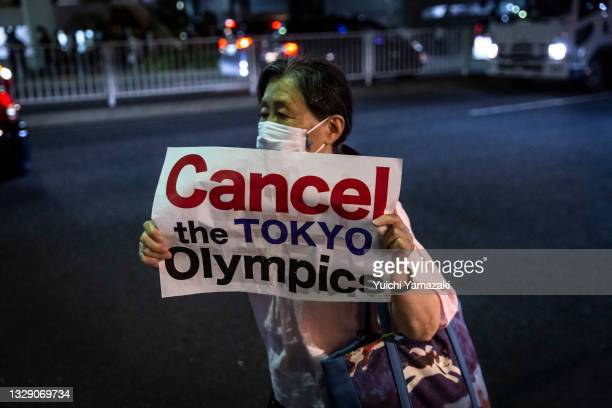 Woman holding a placard marches during a demonstration against the forthcoming Tokyo Olympic Games on July 16, 2021 in Tokyo, Japan. Protesters...