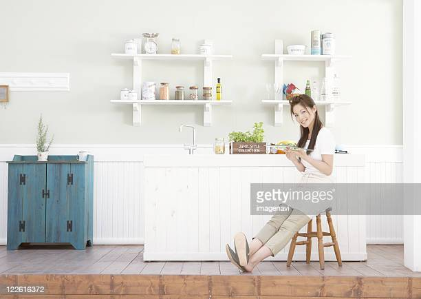 Woman holding a plate of salad