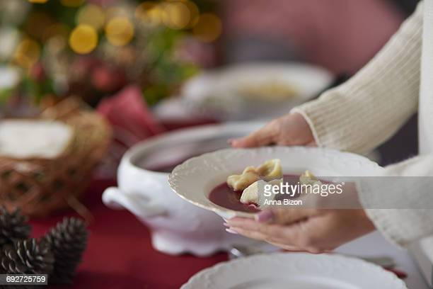 Woman holding a plate with beetroot soup. Debica, Poland
