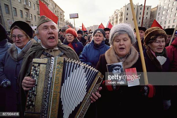 Woman holding a portrait of Stalin at a ProCommunist demonstration on the 75th anniversary of the Bolshevik Revolution