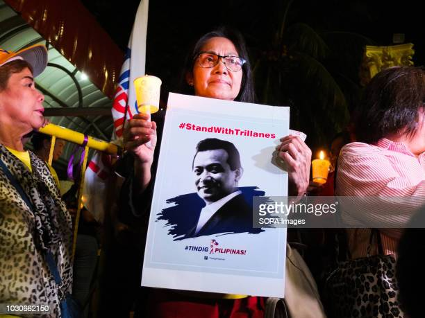 A woman holding a poster of Philippine Senator Antonio Trillanes Supporters of the beleaguered Philippine Senator Antonio Trillanes join the Mass...