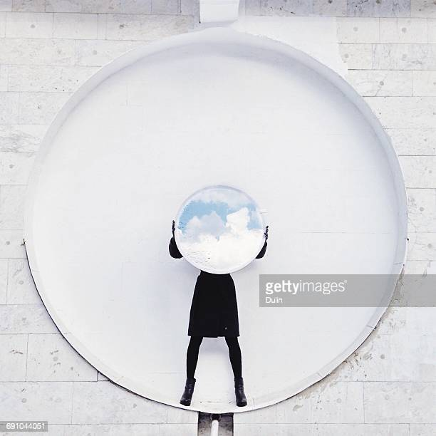 Woman holding a reflector