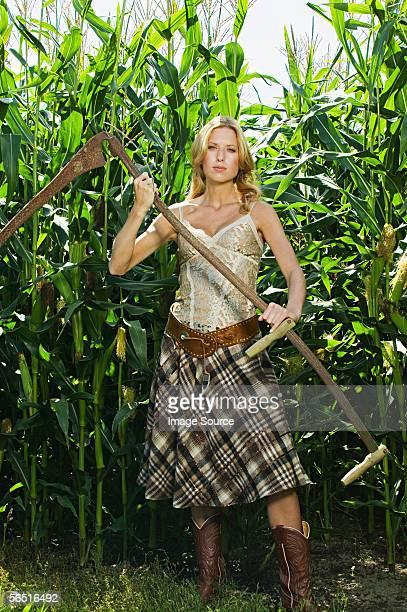 woman holding a scythe - scythe stock photos and pictures