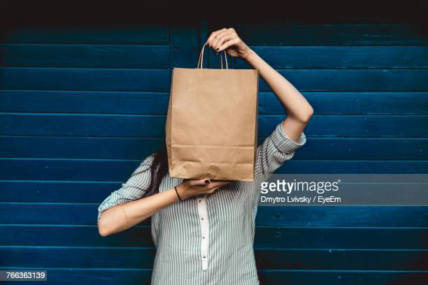 woman holding a shopping bag - shopping bag stock pictures, royalty-free photos & images