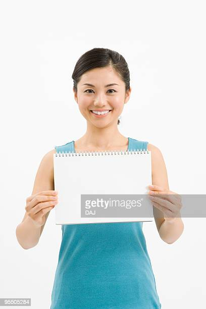 Woman holding a sketch book