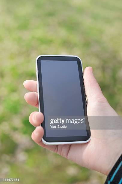 Woman holding a smart phone.